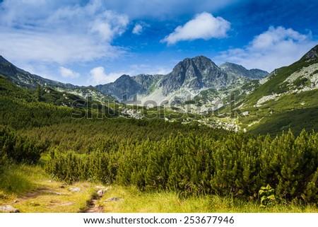 Mountain summits under clouds, Retezat mountain, Romania - stock photo