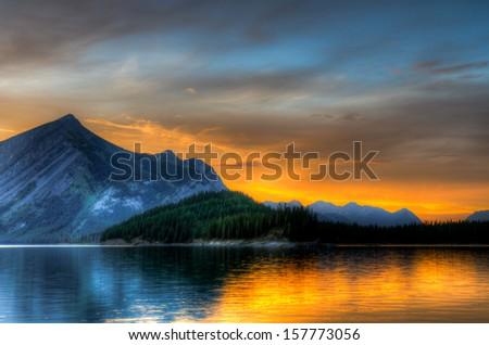 Mountain sunset over Kananaskis Lake, Alberta Canada - stock photo