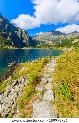 Mountain trail from Morskie Oko to Czarny Staw lake in summer, High Tatra Mountains, Poland - stock photo
