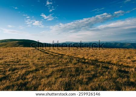 Mountain travel. Road - stock photo