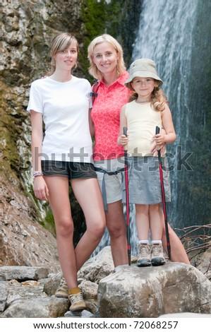 Mountain trek - mother with daughters on trek - stock photo