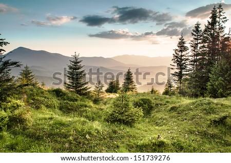 mountain valley at sunset - stock photo