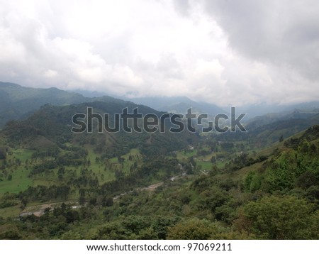 Mountain valley landscape and cloudy sky