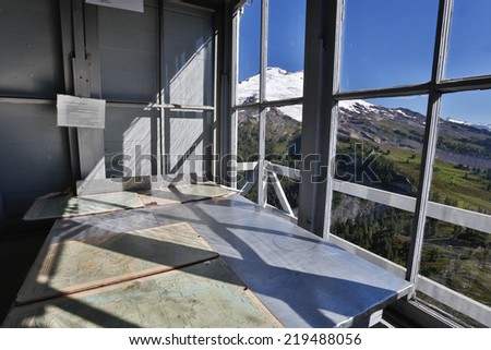 Mountain view through a window from inside of the  fire lookout  - stock photo