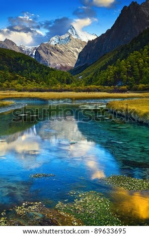 Mountain view with lake reflection - stock photo