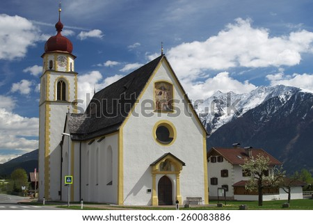 Mountain village church in Tirol, Austria - stock photo