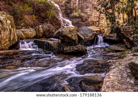 Mountain Waterfall. Waterfall flows through a ravine of the Great Smoky Mountains National Park in North Carolina.  - stock photo