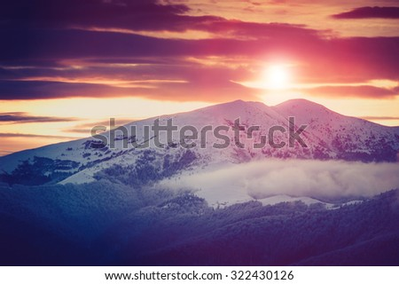 Mountain winter landscape. Fantastic evening glowing by sunlight.Retro filter. Filtered image: instagram toning effect. Happy New Year! - stock photo