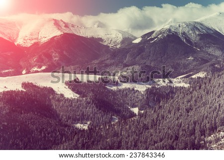 Mountain winter landscape. Fantastic morning glowing by sunlight.  Retro filter and Instagram toning effect.  - stock photo