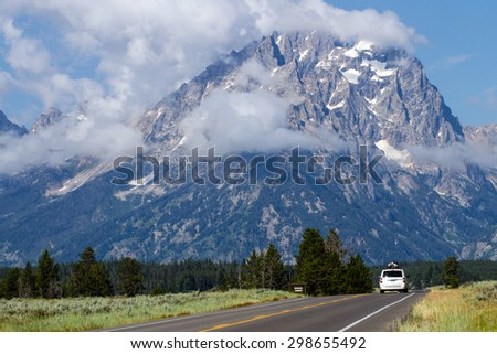 Mountain with a fogbank rising from the Snake River in Grand Teton National Park - stock photo