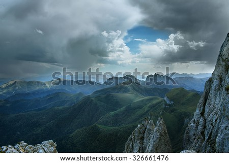 mountain with snow under blue sky - stock photo