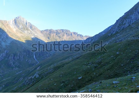 Mountain Zopetspitze and alpine stream at sunrise in Hohe Tauern Alps, Austria - stock photo