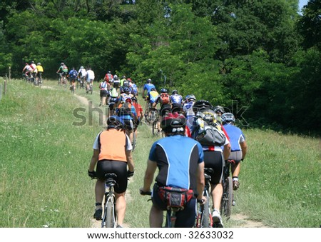 Mountainbike maraton competition in a hills area - stock photo