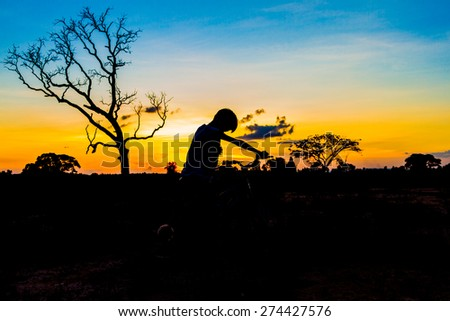 mountainbike silhouette in sunset sky background - stock photo
