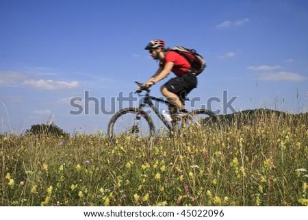 Mountainbiker on Tour - stock photo