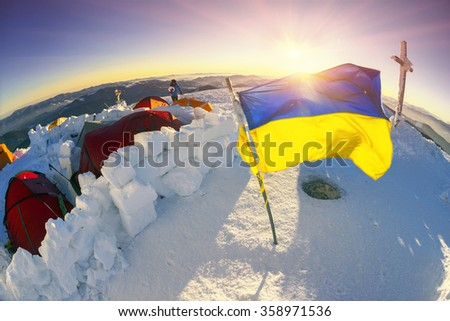 Mountaineer carries snow- stoke tea. Climbers tradition to celebrate the New Year holiday on the highest peak of Ukraine - Goverla, Montenegrin Mountains. Severe frost danger wind - stock photo