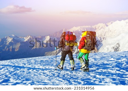 Mountaineer climb to the high mountain peak - stock photo