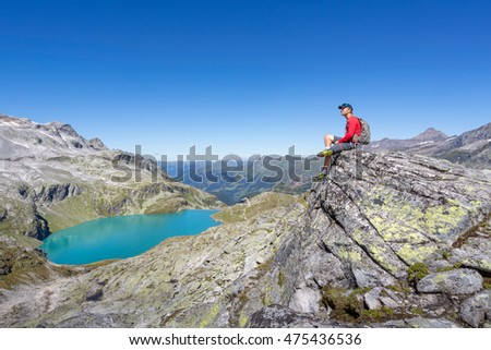 Mountaineer enjoying the view in the alps
