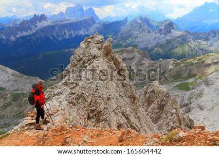 Mountaineer following the trail to Falzarego pass, Dolomite Alps, Italy - stock photo
