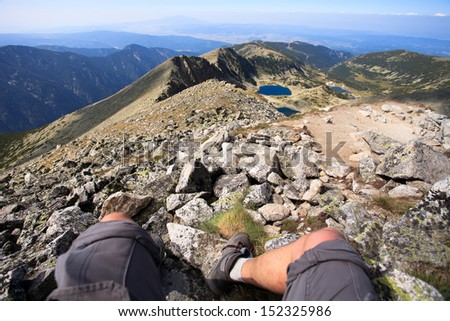 mountaineering close-up feet and panoramic view from Musala peak in bulgaria
