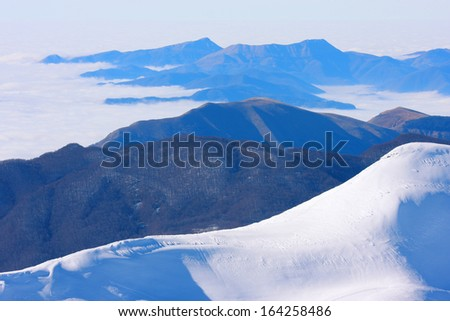 mountaineering excursions northern Apennines ski resorts winter sports ski lifts sports and nature horn of the stairs regional park - stock photo