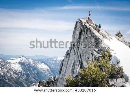 Mountaineers at summit of mountain in the Trinity Alps. - stock photo