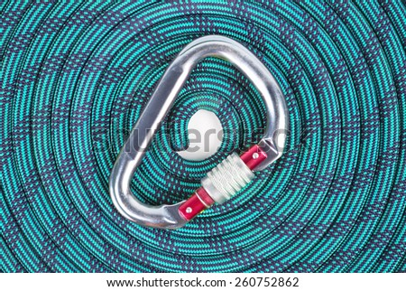 Mountaineers' carabiner with climbers rope - stock photo