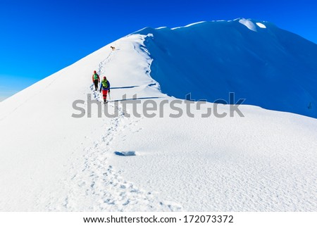 Mountaineers walking on the Kosuta ridge in Karavanke range, Slovenia - stock photo