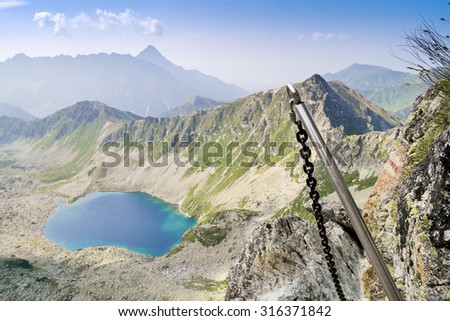 Mountainous adventure on extreme trail with chains - stock photo