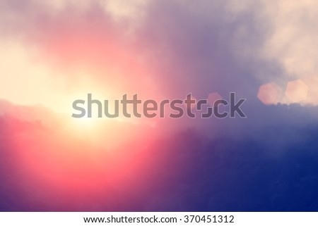 Mountains against the evening sky and setting sun - stock photo
