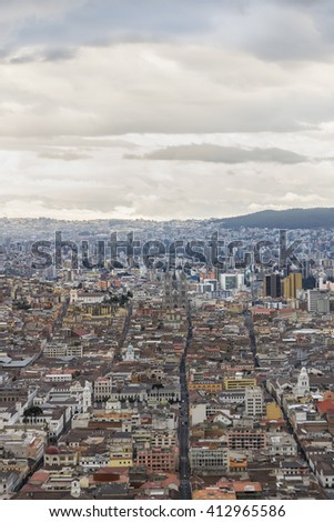 Mountains and cityscape panoramic aerial view from panecillo viewpoint of Quito city, Ecuador. - stock photo