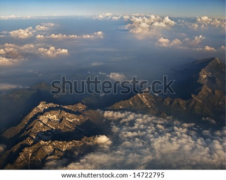 Mountains and Clouds from plane - stock photo