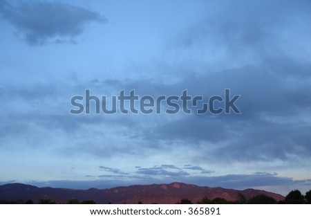 Mountains and Clouds over Albuquerque, New Mexico during sunset - stock photo