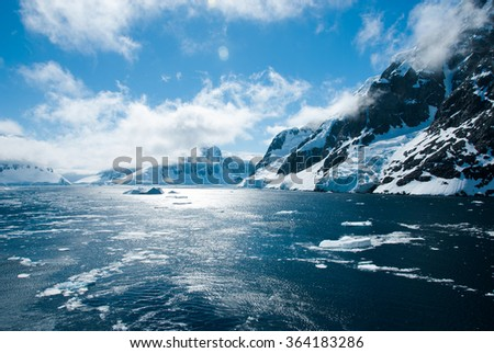 Mountains and ices of Antarctica in a beautiful sunny day - stock photo
