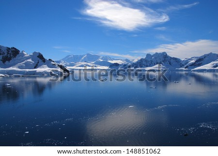 Mountains and reflections in Antarctica - stock photo