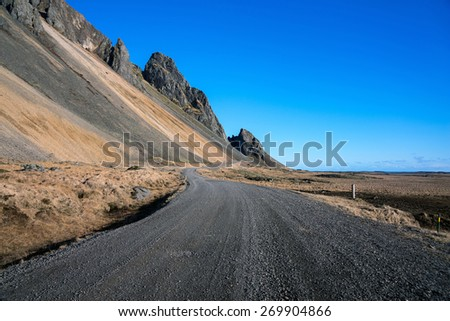 Mountains and road on the southern coast of Stokksness, Iceland - stock photo