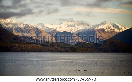 Mountains at sunrise with lake in foreground