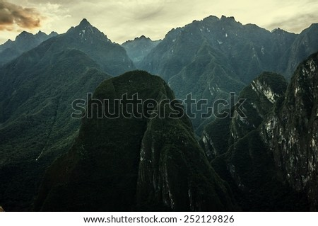 Mountains covered in green plants.  - stock photo