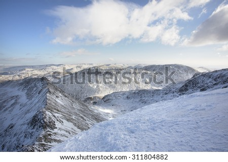 mountains covered in snow and ice in winter at helvellyn, lake district - stock photo
