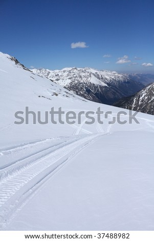 Mountains - Dombay, Main Caucasian ridge, abt. 4000m. Tracks of snowmobile