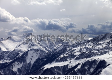 Mountains in evening and cloudy sky. Caucasus Mountains. Georgia, ski resort  - stock photo