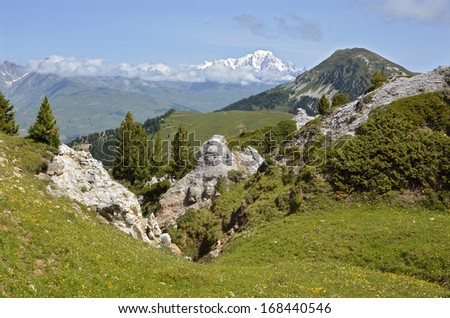 Mountains in the french Alps and snowy Mont Blanc massif in the background at La Plagne, commune in the Tarentaise Valley,Savoie department and Rhone-Alpes region in France - stock photo