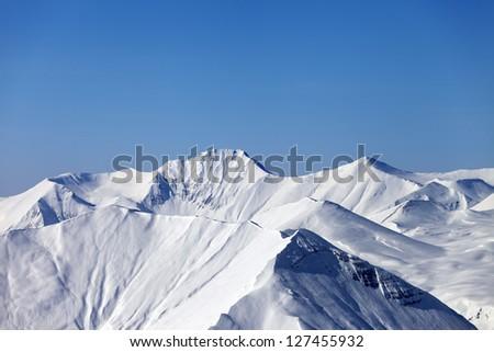Mountains in winter. Caucasus Mountains, Georgia, view from ski resort Gudauri. - stock photo