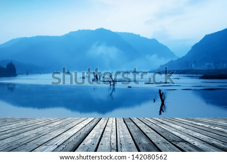 Mountains, lakes and the early morning fog. - stock photo