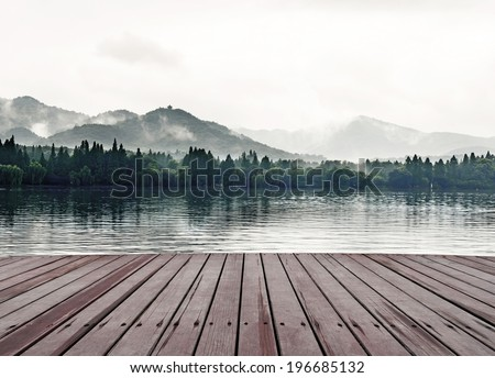 Mountains, lakes and the early morning fog - stock photo
