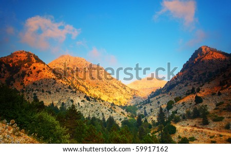 Mountains landscape valley peaceful sunset scene - stock photo