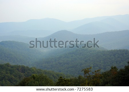 Mountains layered in the background. - stock photo