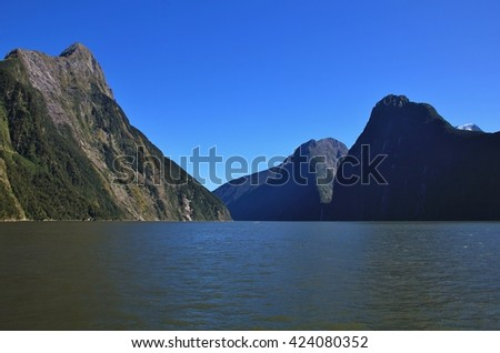Mountains Mitre Peak, The Lion and The Elephant. Summer scene in the Milford Sound, New Zealand. - stock photo