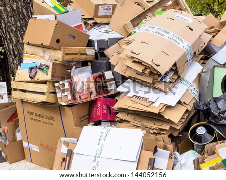 mountains of cardboard on the street. of packaging waste paper is collected. - stock photo