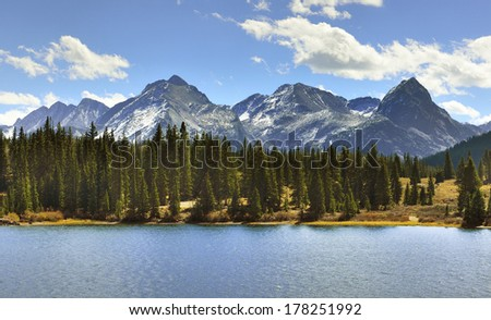mountains of Colorado, a lake and clouds - stock photo